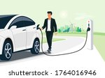 man charging electric car on... | Shutterstock .eps vector #1764016946