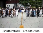 Small photo of PESHAWAR, PAKISTAN - JUN 26: A large number of citizens gather as they are holding protest to condemn inhu¬man and immoral attitude of police against Amir Te¬hkali, on June 26, 2020 in Peshawar.