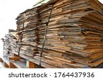 Small photo of Used paper boxes in industrial plants that are stacked on wooden legs To prepare to resell to the factory to buy recycled antiques