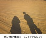 Shadow Of Two People On  The...