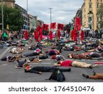 Small photo of Berlin 21/6/2020 the protesting group called Extinction Rebellion are lying on the ground as an act of nonviolent civil disobedience to make governments take action to address climate change.