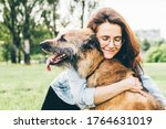 Women Hugging Dog In The Summe...