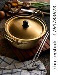 Small photo of Korean Ramen Noodle Pot or Yellow Aluminum Stockpot Instant Noodle Pot. Korean Traditional Style. Selective Focus.