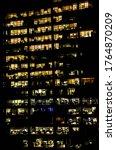 an office building at night ...   Shutterstock . vector #1764870209