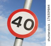 Small photo of Forty miles per hour speed limit sign against a partly cloudy sky.