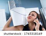 worried woman holding bucket... | Shutterstock . vector #1765318169