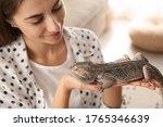 Woman Holding Bearded Lizard...