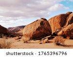 Massive Boulder In A Desert...