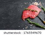 Raw Flat Iron Steak With...
