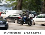 Man Riding A Motorbike In Busy...