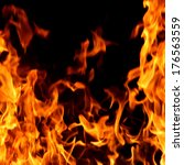 red fire and flames background | Shutterstock . vector #176563559