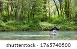Fly fisherman with black jacket ...