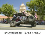 flag adorned jeep demonstrates... | Shutterstock . vector #176577560