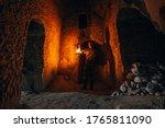 Man With Kerosene Lamp Explores ...