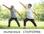 Senior Couple Doing Stretching...