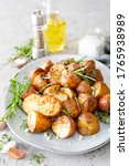 Baked potatoes with rosemary ...