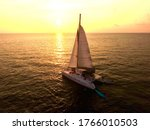 Sunset On Sailing Catamaran At...