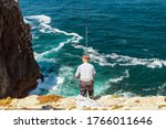 Elderly Man Fishing With A Rod...