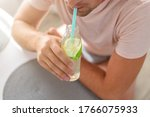 Man Drinks Lemonade Through A...
