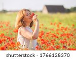 Happy Woman In A Poppy Field In ...