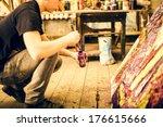 artist's hand with paintbrush... | Shutterstock . vector #176615666