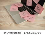 Small photo of Image of laptop full of sticky notes reminders on screen. Work overload concept image. Coworking or working at home concept image.