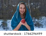 A Girl In A Blue Hood With A...