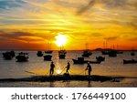 Fisherman Fishing At Sunset Sea