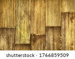 Background of old shabby light brown planks located ledge close-up.