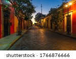 Street of Oaxaca city at sunrise with its colonial style architecture, Oaxaca state, Mexico.