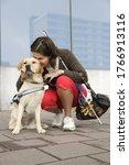 Blind Woman Hugging Seeing Eye...