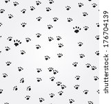 Stock vector cat paw prints vector seamless background 176704139