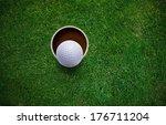 golf ball on lip of hole . | Shutterstock . vector #176711204