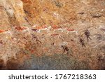 Small photo of Bushmen rock paintings White Lady in Brandberg mountain area in Namibia. A spiritual site of great significance to the San (Bushman) tribes. Prehistoric archeological sign.