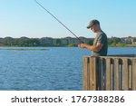 Fisherman Throws A Fishing...