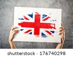 great britain flag. man holding ... | Shutterstock . vector #176740298