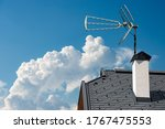 Closeup Of A House Roof With A...