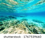 Underwater view of rocks and sand in Alghero sea bed. Sardinia, Italy - stock photo