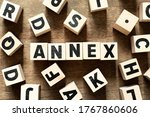 Small photo of Wood letter block in word annex on wood background with another alphabet