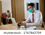 Businessman With Face Mask...