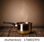 cooking pot on old wooden table | Shutterstock . vector #176802593