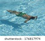 single man swimming underwater... | Shutterstock . vector #176817974