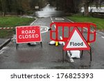 Road Closed And Flood Sign Due...