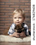 boy with puppy. child lovingly... | Shutterstock . vector #176829608
