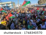 Small photo of Palestinian supporters of Fatah movement go out in a march in support of the joint conference between Hamas and Fatah in Ramallah against plans to annex Israel to the West Bank, on July 2, 2020.