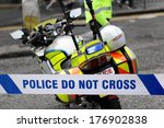 Policeman And Police Motorcycl...