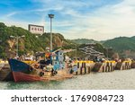 """Small photo of Fuao Harbor at Nangan island, Matsu, Taiwan. translation of the chinese text is """"make a spear as pillow to wait for the daybreak"""" It means all set to start the battle"""