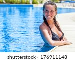 smiling woman is relaxing in... | Shutterstock . vector #176911148