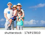 happy beautiful family on a... | Shutterstock . vector #176915810