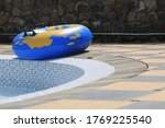 Small photo of a blue swimming tire floater beside the pool